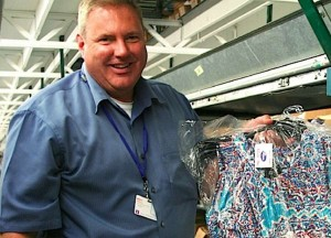 Mike Willem, Variety Wholesalers senior vice president of distribution and transportation, holds clothing that is being sorted at the distribution center in Newnan. The clothing will shipped to Roses stores throughout the Southeast.